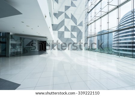 modern building interior and view of building through window - stock photo