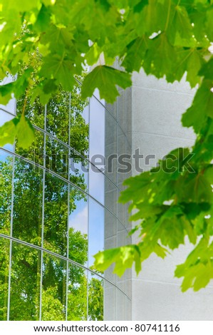 modern building reflects nature - stock photo