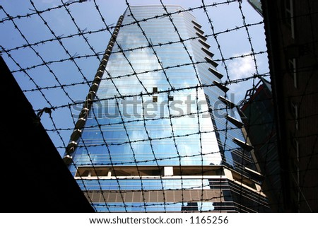 modern building viewed from a old prison - stock photo