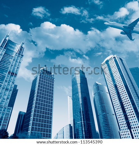 modern building with airplane under the sky in shanghai - stock photo