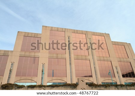 Modern building with gold tinted glass - stock photo
