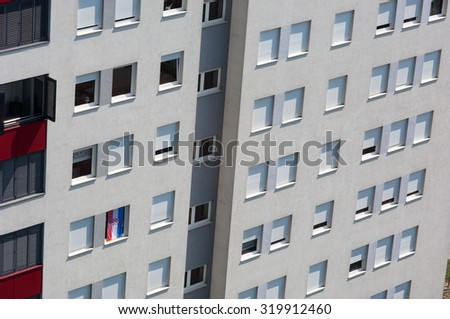 Modern building with windows and croatian flag. - stock photo