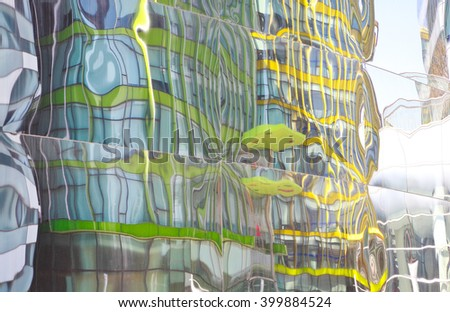 Modern buildings glass walls reflecting abstract distorted reflection - stock photo