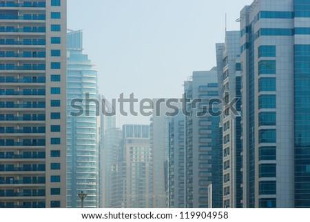 Modern buildings in the fog - stock photo