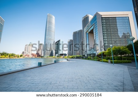 modern buildings in tianjin financial district with beautiful scene beside the haihe river , China - stock photo
