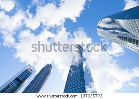 Modern buildings, skyscrapers. Office buildings against the cloudy blue sky. Skyscrapers view with blue sky