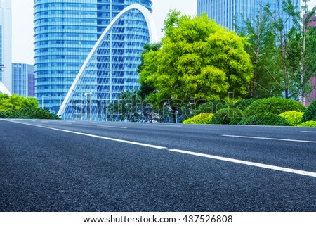 modern buildings with empty road under blue sky,tianjin china. - stock photo