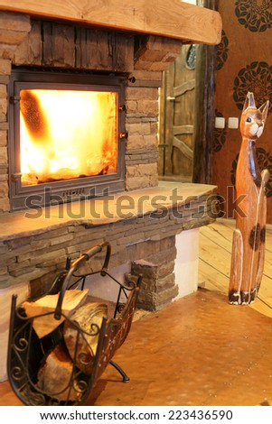 modern burning fire place in cozy house - stock photo