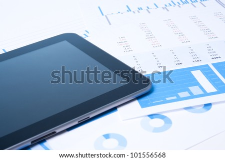 Modern business analysis with digital tablet computer, sheet and graphs. - stock photo