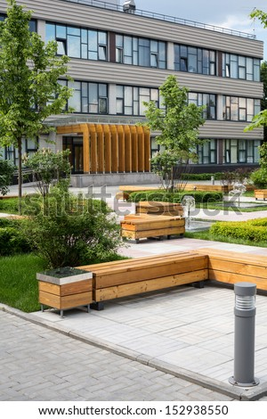 Modern Business Center with green trees, benches and fountains  - stock photo