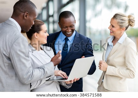 modern business group using laptop computer in office - stock photo