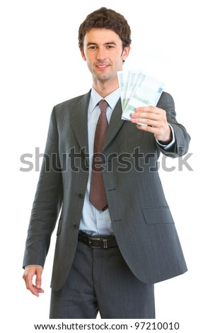 Modern business man showing pack of euros