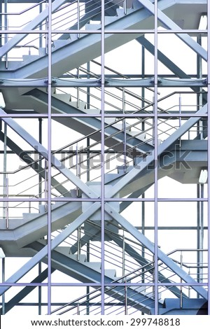 Modern business office stairs with steel handrail in new building with transparent glass walls, architectural geometric abstraction