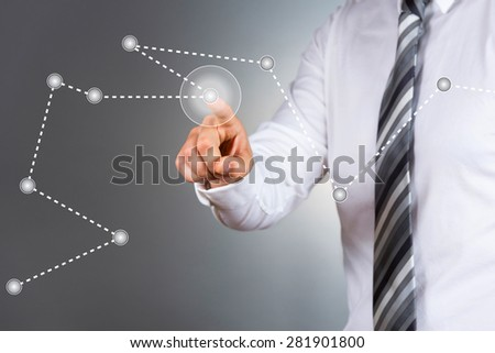 Modern business pointing at business graph.