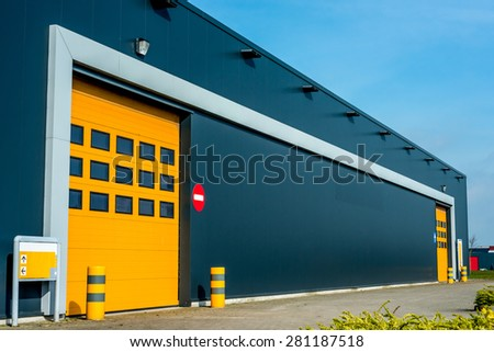 Modern business unit with yellow door - stock photo