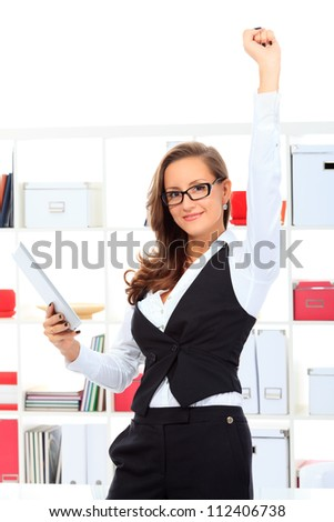 Modern business woman at the office showing success. - stock photo