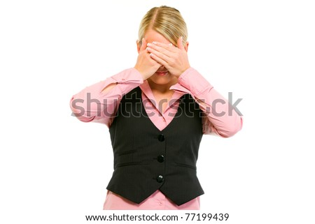 Modern business woman making see no evil gesture isolated on white - stock photo