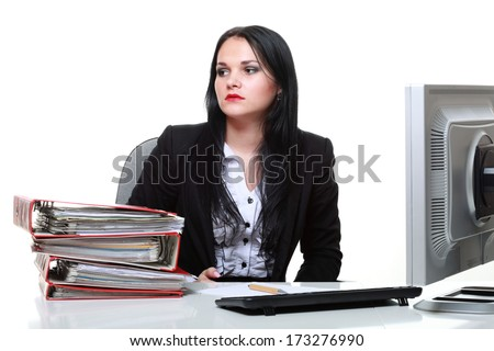 modern business woman sitting at office desk isolated on white background - stock photo