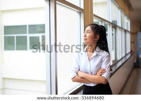 Modern business woman standing and smile in the office with copy space