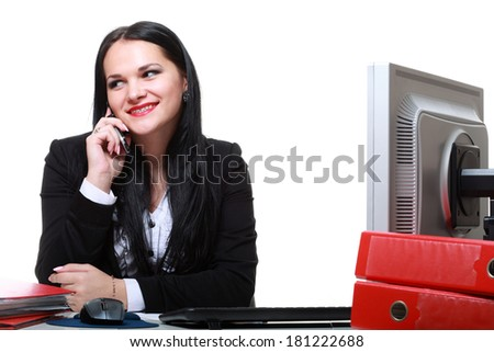 modern business woman talking phone sitting at office desk - stock photo