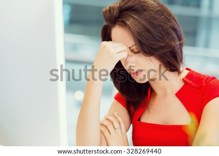 Modern business woman thinking about something - stock photo