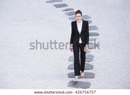Modern business woman walking on the path