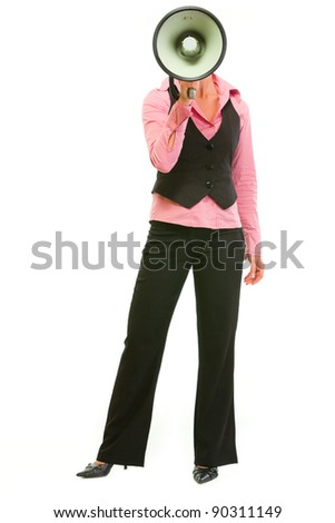 Modern business woman with megaphone in front of head - stock photo