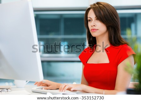 Modern business woman working on computer