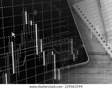 Modern business workplace with stock market data application on a digital tablet - stock photo