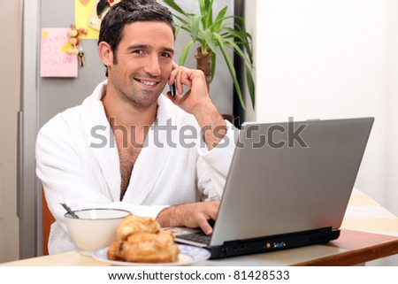 modern businessman having breakfast at home