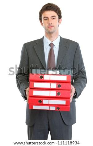 Modern businessman holding pack of folders - stock photo