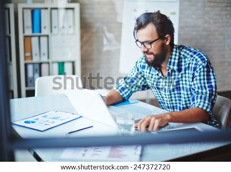 Modern businessman in casualwear networking - stock photo