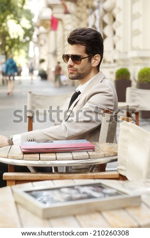 Modern businessman sitting at coffee shop. Business people. - stock photo