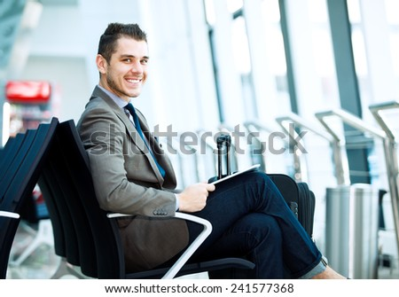 modern businessman using tablet computer at airport - stock photo