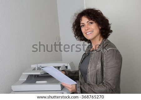 Modern businesswoman in the office at work  - stock photo