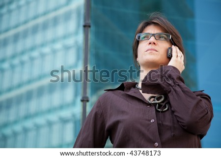 Modern businesswoman talking on the cellular - stock photo