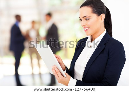 modern businesswoman using tablet computer - stock photo