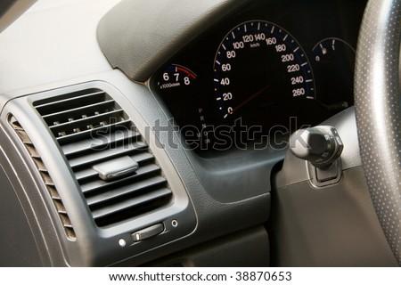 Modern car dashboard closeup photo - stock photo