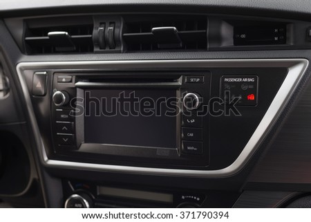 Modern car dashboard. Multimedia screen and navigation system.