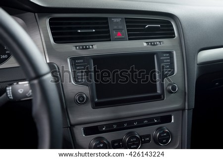 Modern car dashboard. Screen multimedia system. Interior detail.