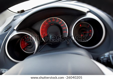 Modern car dashboard with moving arrows - stock photo