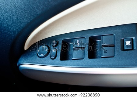 modern car door panel control - stock photo