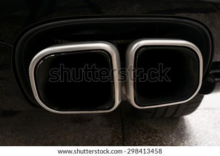 Modern car exhaust. Auto exterior detail. - stock photo
