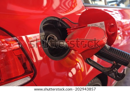 modern car fuel up in gas station