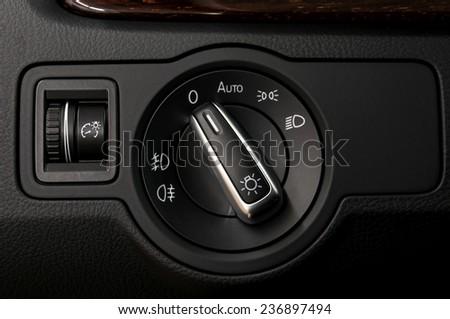 Modern car headlight controls. Automobile interior detail. - stock photo