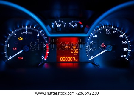 Modern car illuminated dashboard closeup - stock photo