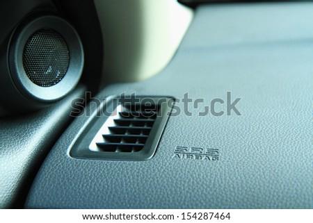 Modern car interior, airbag panel and air ventilation - stock photo