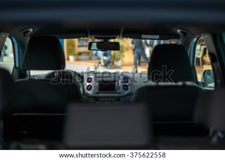 Modern car interior and dashboard. Screen multimedia system.