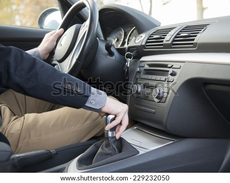 modern car interior and man driving - stock photo