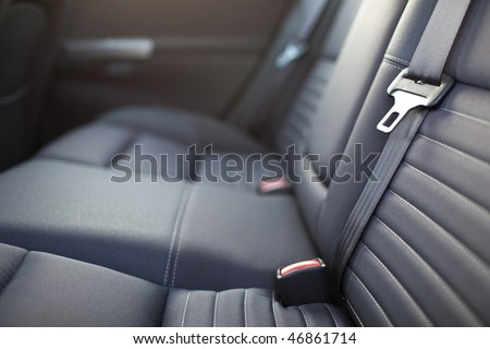 Modern car interior - rear seats with the seat belts - stock photo